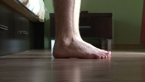 Male feet getting out of bed. In the morning stock video