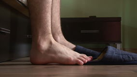 Male feet getting out of bed Royalty Free Stock Photos