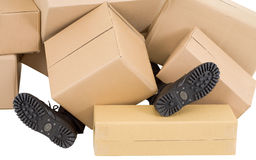 Male feet and heap of boxes Stock Photo