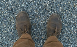 Male feet in leather brown shoes and mustard trousers Royalty Free Stock Photography