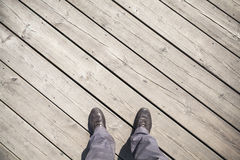 Male feet in leather shoes stand on old pier Stock Photo