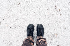 Male feet in leather shoes standing in snow from above. With copy space, winter season background Royalty Free Stock Photos