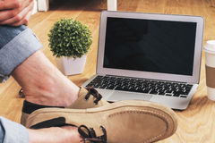 Male feet notebook Stock Image