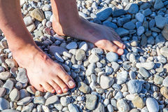 Male feet on rocks Stock Photography