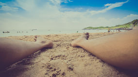 Male feet on the sandy beach Royalty Free Stock Photo