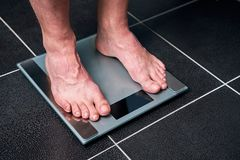 Male feet on the scale stock photos