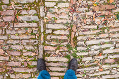 Male feet in shoes stand on old cobblestone Stock Photography