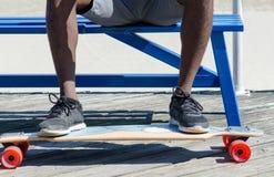 Male feet on skateboard Stock Photos