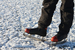 Male feet in the skates on a snow surface Stock Images