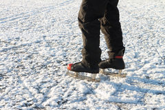 Male feet in the skates on a snow surface Royalty Free Stock Photos