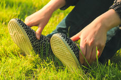 Male feet and sneakers. With socks and jeans Royalty Free Stock Photography