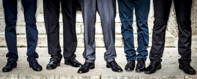 Male feet in suits, front view Stock Photos