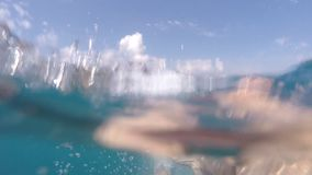 Male feet swimming underwater on sea during summer vacation. Point of view of young man. POV Close up Slow motion.  stock video footage