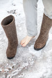 Male feet with traditional Russian gray felt boots Stock Photo