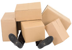 Male feet under a heap of boxes Stock Images