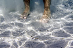 Male feet underwater in the sea Royalty Free Stock Image