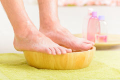 Male feets in a bowl Stock Image
