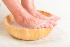 Male feets in a bowl Stock Photos