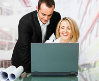 Male and female architects working Royalty Free Stock Photos