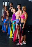 Male and female athletes exercising with resistance band Stock Photos
