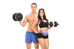 Male and female athletes posing with barbells. Isolated on white background Royalty Free Stock Images