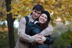 Male and female in autumn park Royalty Free Stock Photos
