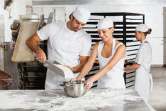 Male And Female Baker's Working Together In Bakery Royalty Free Stock Photos