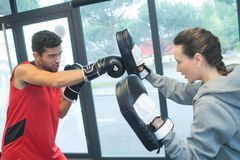 Male and female boxer with fighting stance. Female royalty free stock image