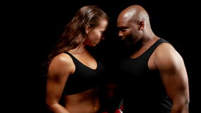 Male and female boxer looking at each other stock video