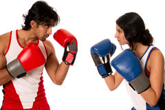 Male and Female Boxers. Battle of the sexes. Studio shot over white Royalty Free Stock Images