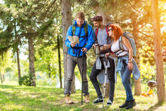Male and female in a break from hiking in forest Stock Photography