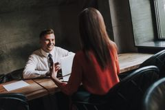Male and female business coleagues discussing work. Concept of successful work process. Portrait of handsome young businessman listening his female partner while stock photos