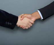 Male and female business handshake. Close up male and female business people handshake Royalty Free Stock Image