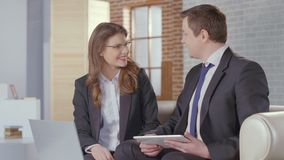 Male and female business partners come to agreement, shake hands stock video