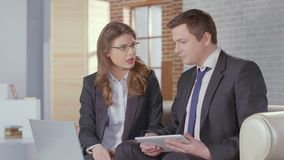 Male and female business partners completing deal, shaking hands. Stock footage stock video footage