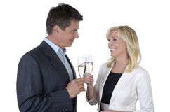 Male and female business people celebrating with Champagne Stock Images