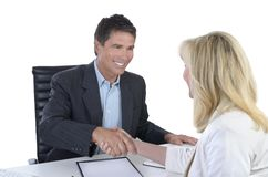 Male and female business people shaking hands Royalty Free Stock Image
