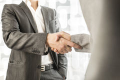 Male and female business or political partners shaking hands in Stock Photos