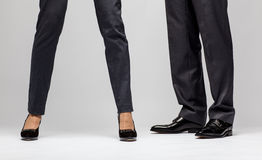 Male and female businessperson's legs Stock Image