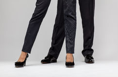 Male and female businessperson's legs Royalty Free Stock Image