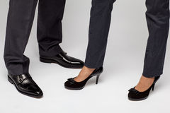 Male and female businessperson's legs Royalty Free Stock Photos