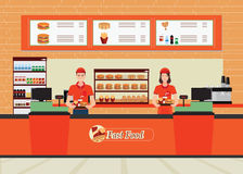 Male and female cashier at fast food restaurant  interior. Stock Photos
