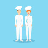 Male and Female chef in flat design. Stock Image