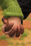 Male & female clasping hands. Couple holding hands Royalty Free Stock Photo