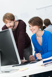 Male and female co-workers at the office Royalty Free Stock Images