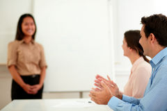 Male and female colleagues giving applause Stock Images
