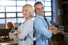 Male and female colleagues standing back to back Royalty Free Stock Photo