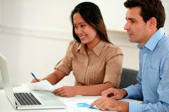 Male and female colleagues working on documents Royalty Free Stock Photos