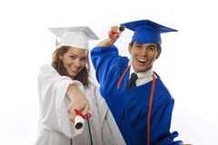 Male and female college graduates Stock Images