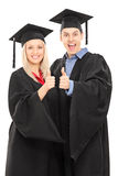 Male and female college students giving thumbs up. Isolated on white background Stock Images